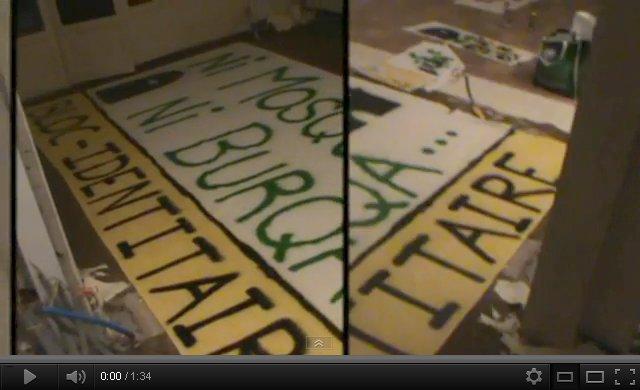 création de la banderole déployée sur la rambarde d'un pont enjambant le périphérique de toulouse : ni mosquéee ni burqa... bloc-identitaire